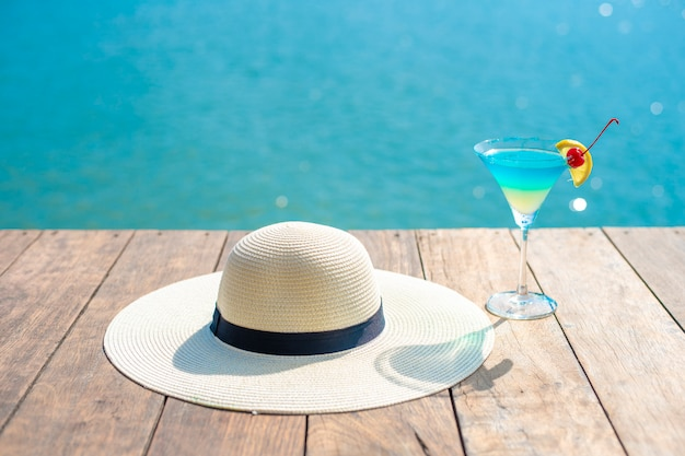 Summer background , white hat and summer drinking on beach