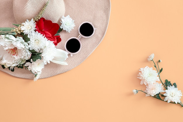 Summer background with flowers and a hat.