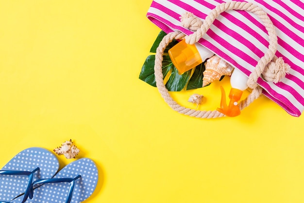 Summer bag background with copy space. flat lay photo on color table, travel concept. free space for text, mock-up.