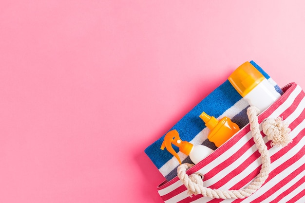 Summer bag background with copy space. flat lay photo on color table