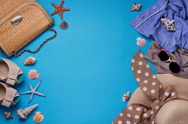 Summer beach accessories on blue background