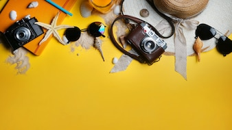 Summer Beach Accessories on Yellow Background. Flat Lay Copy Space
