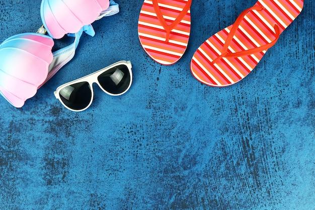 Summer beach accessories on wooden vintage background.