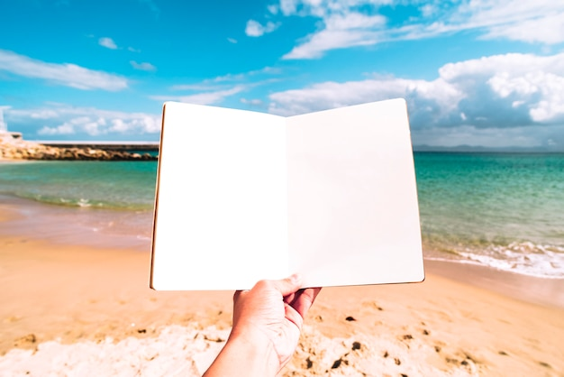 Summer beach background with a blank notebook