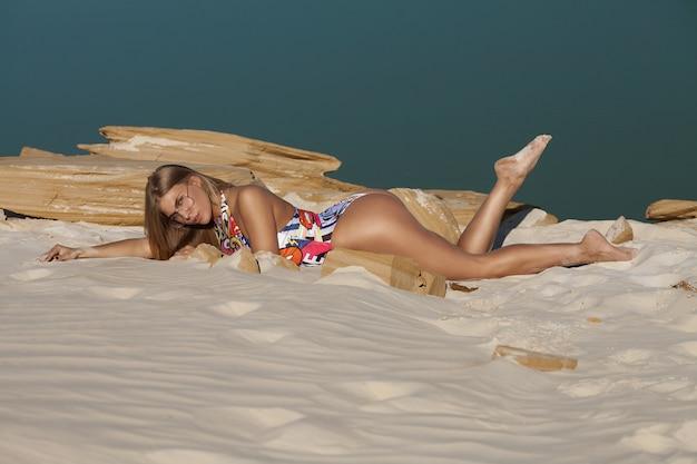 Summer beach concept. sandy woman buttocks on the beach.