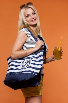 Summer. beautiful blonde with juice