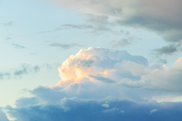 Summer blue sky with a thundercloud. large fluffy white clouds.