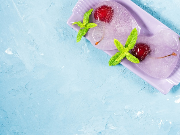 Summer blue textured ice hearts frozen cherries