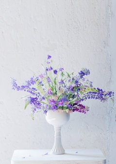Summer bouquet in blue and violet colors on white background