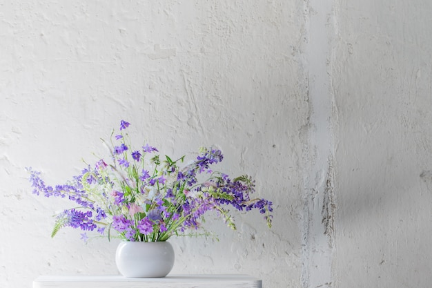 Summer bouquet in blue and violet colors on white