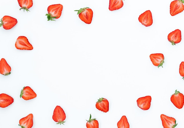 Summer bright background with strawberries on a gray surface and place for text in the middle