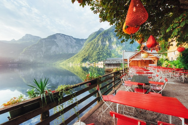 Summer cafe on the beautiful lake between mountains. alps. hallstatt. austria