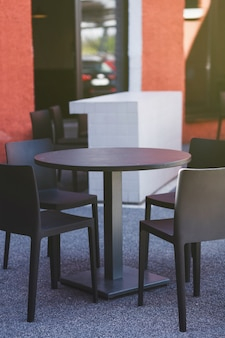 Summer cafe in europe. stylish terrace - tables and chairs