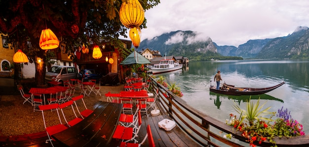 Summer cafe on the shore of a mountain lake