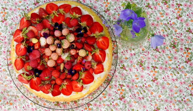 Summer cake with fresh ripe strawberries and  pineberry with mascarpone cream