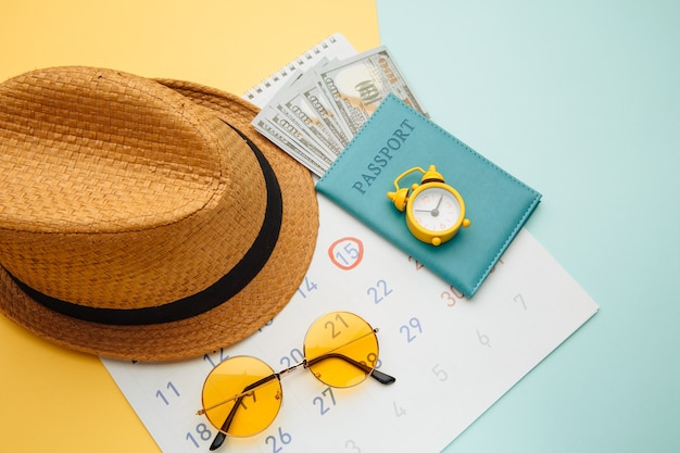Summer calendar schedule with travel accessorises. travel, tourism, holiday concept