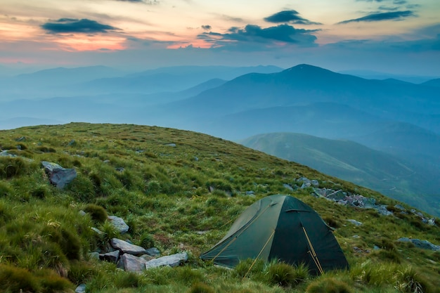 Summer camping in mountains at dawn