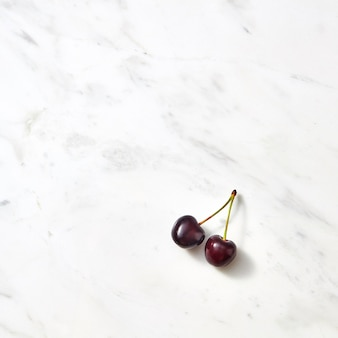 Summer cherries minimal background with place under text. flat lay.