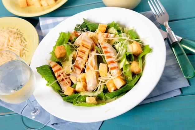 Summer chicken caesar salad on picnic table