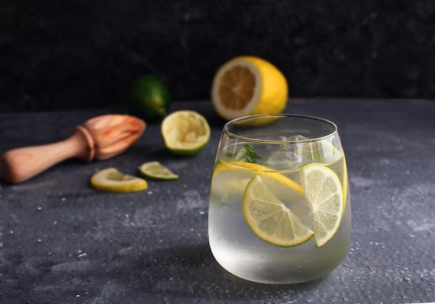 Summer citrus lemonade with squeezed lemon and lemon reamer or juicer