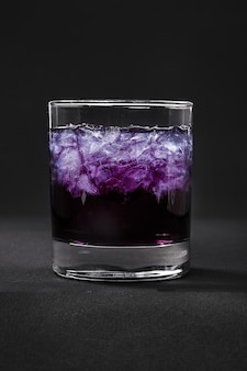 Summer cocktail on isolated black