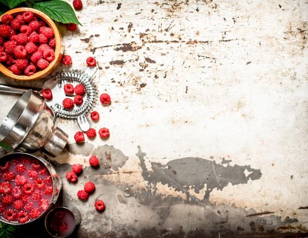 Summer cocktail of wild raspberries.