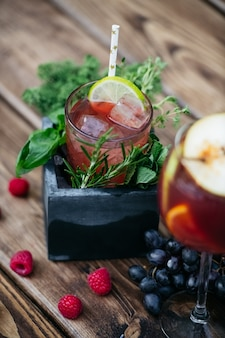 Summer cocktail with fruits in stone box