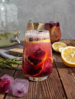 Summer cocktail with ice and flowers