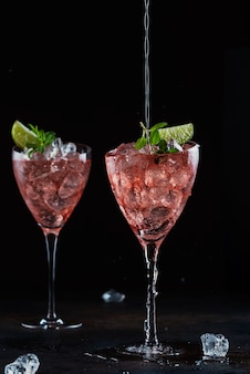 Summer cocktail with rose wine