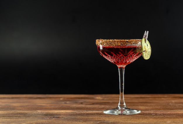 Summer cocktail on a wooden table