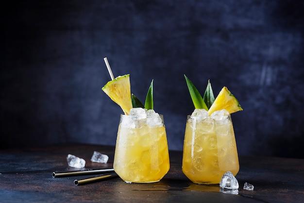 Summer cocktails on dark table