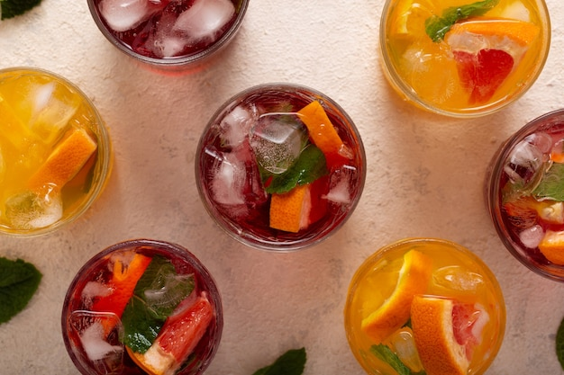 Summer cocktails and drinks with fruits and ice