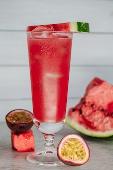 Summer coctail with watermelon on a wooden table