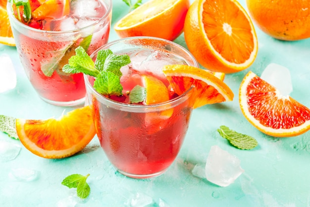 Summer cold drink, blood orange mint cocktail  mimosa, mojito or sangria,  light blue , copyspace
