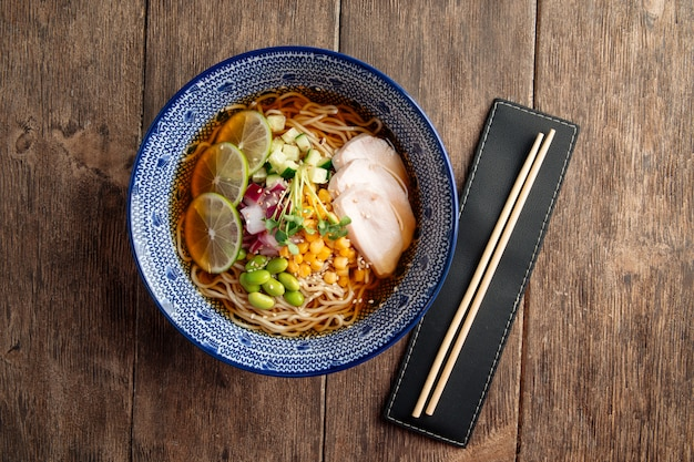 Summer cold ramen noodle soup with chicken