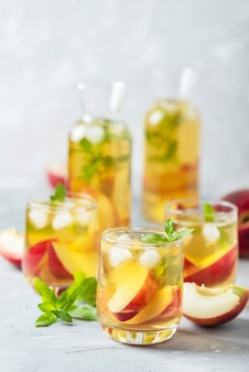 Summer cold tea with peaches and mint