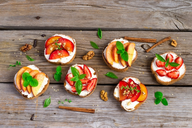 Summer colorful bruschetta appetizer with fruit, curd cheese