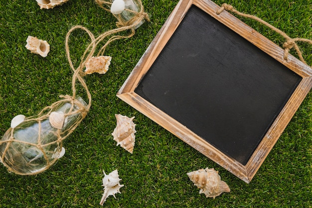 Summer composition with decorative elements and slate for messages