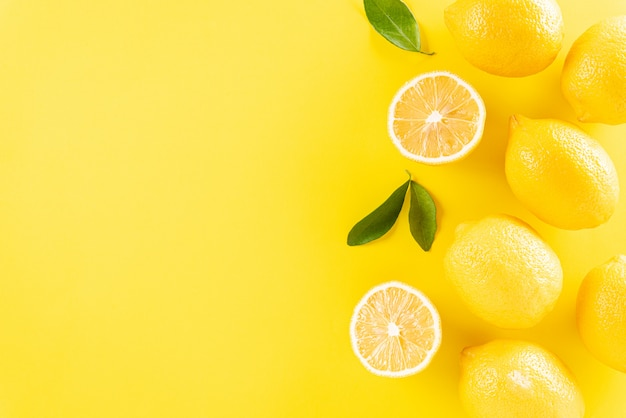 Summer composition with lemons and green leaves