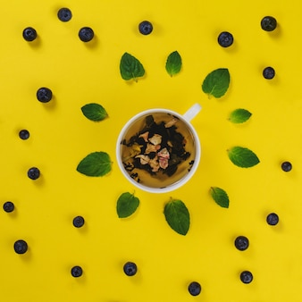 Summer composition with mug and blueberries