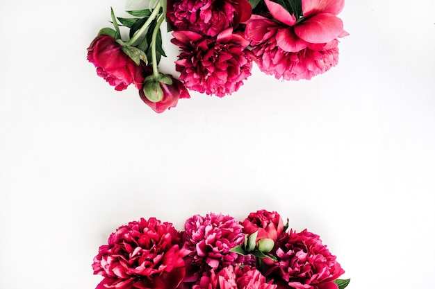 Summer composition with pink peony flowers bouquet on white background. flat lay, top view