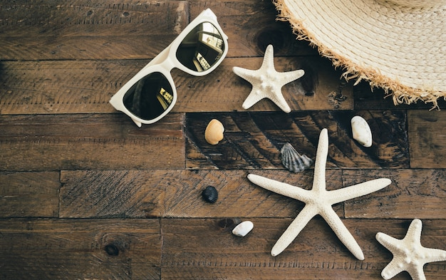Summer composition on wooden table. vacation and travel concept