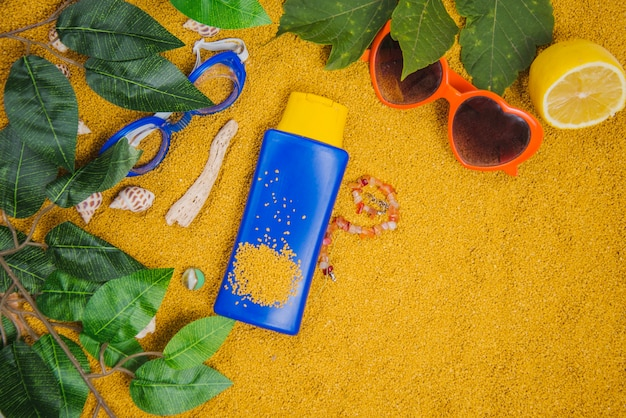 Summer concept with leaves and suncream