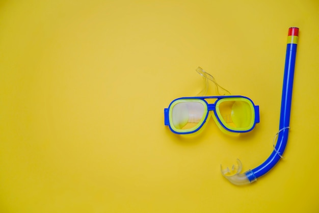 Summer concept with snorkel and goggles