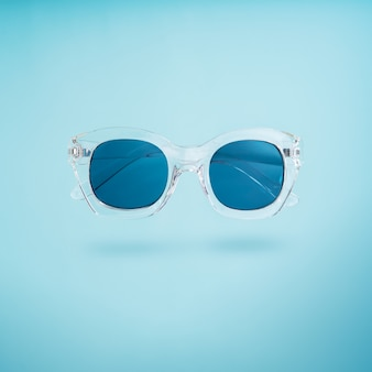 Summer creative concept. minimal style with transparent sunglasses