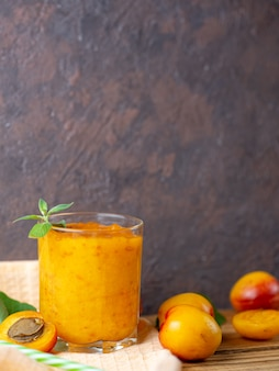 Summer delicious apricot smoothie in a glass
