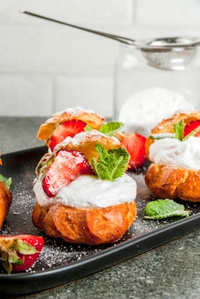 Summer desserts. homemade baking. cake profiteroles with whipped cream