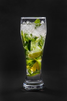 Summer drink with lime and mint isolated black
