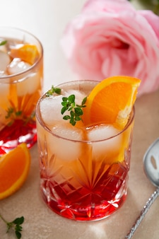 Summer drink with strawberries, oranges and fresh herb, delicious homemade lemonade glasses with syrop