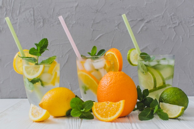 Summer drinks with straws and fruit slices